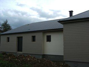 maison en ossature bois avec bardage extérieurs de couleur