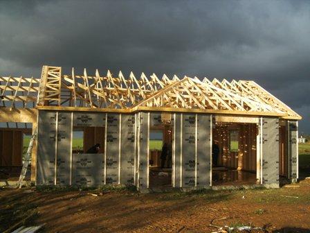 pose par pluie maison bois